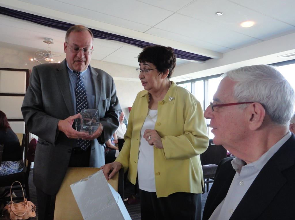 ARC Board member Mike Heller admired the service awards presented to Doris Lyons and Ted Procas